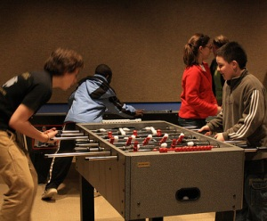 TUTORS member first-year Jim Price plays foosball with one of the participating students, who halls from Mexico.