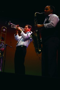 Trumpet player Cristobal Ferrer Garcia, left, traveled through the audience at the concert.