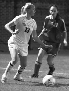 First-year Ashley Cobane looks to pass the ball to a teammate for a goal.